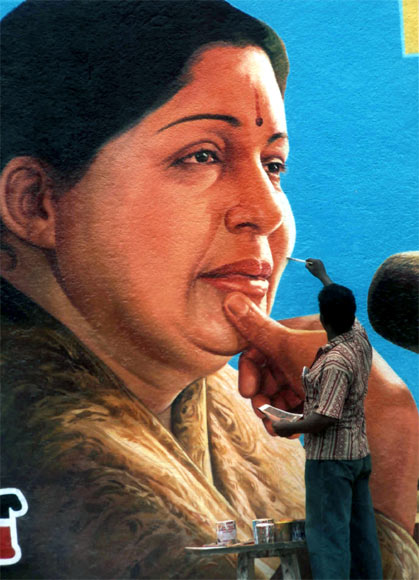 A artist applies the finishing touches to the portrait of Jayalalithaa in Chennai