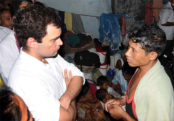 Rahul listens to woes of a youth in a relief camp in Gosaigaon in Assam's Kokrajhar district