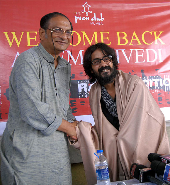 Trivedi with Binayak Sen at the Mumbai Press Club