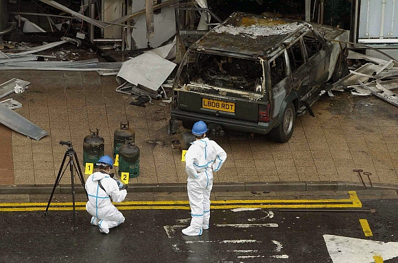 Forensic officers examine the scene of attack on the terminal building at Glasgow Airport Glasgow Scotland