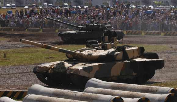 A Russian T-90MS tank and a T-90 tank are seen at a firing ground during a demonstration show