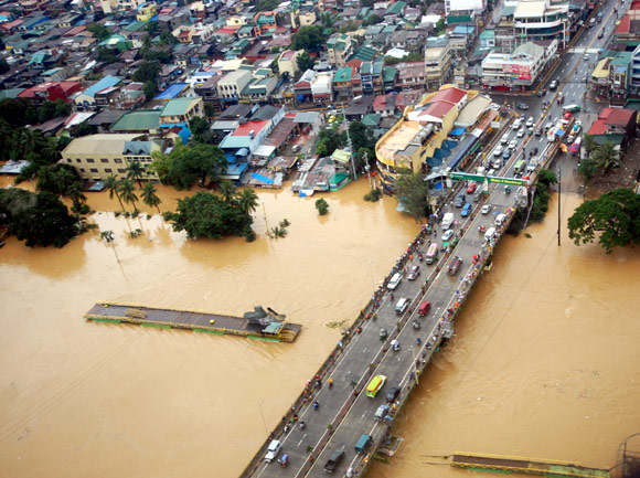 The overflowing Marikina river in Marikina, Metro Manila, is seen in this aerial photograph dated August 8, 2012