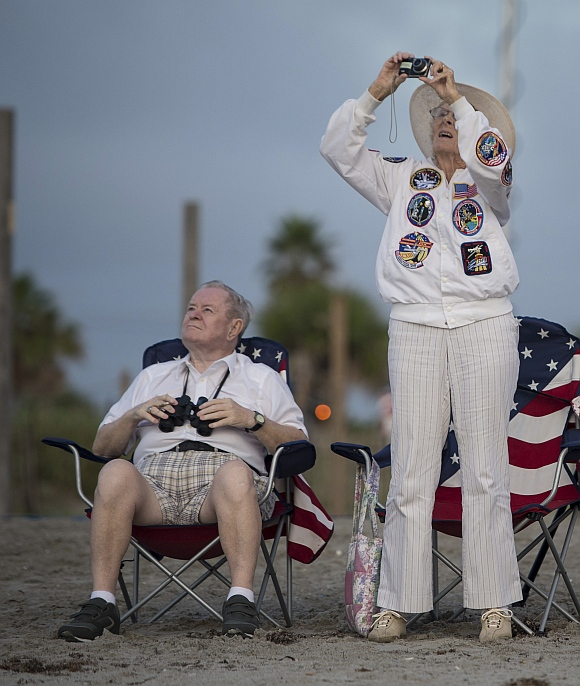 Jorgen and Ruth Sabinsky watch the fly-over of the space shuttle Endeavour atop NASA's Shuttle Carrier Aircraft