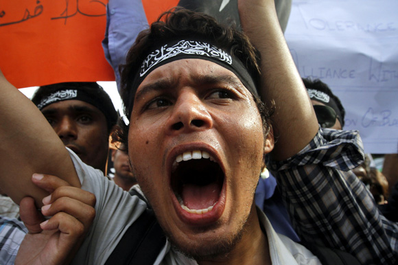 Students shout anti-American slogans during a protest rally in Karachi