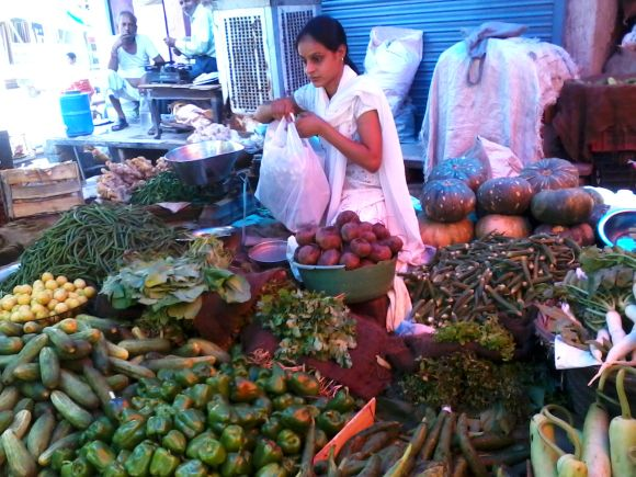 Kamlesh helps her father sell vegetables to ensure her two younger sisters' education isn't obstructed