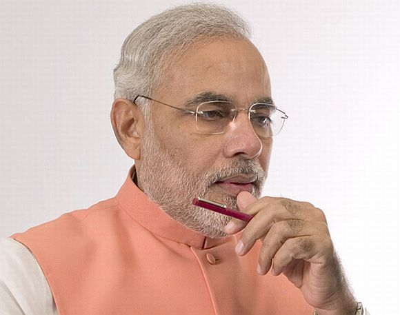 Modi wonders how FDI call came day after Sonia's US trip