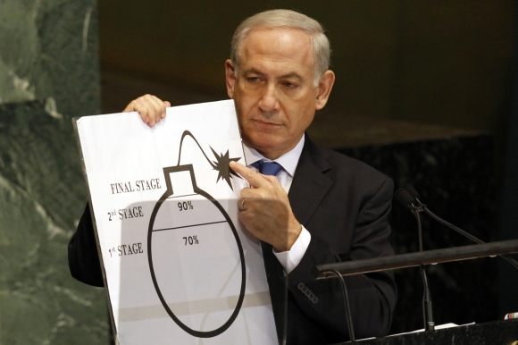 Israeli Prime Minister Benjamin Netanyahu holds an illustration describing Iran's ability to create a nuclear weapon as he addresses the 67th United Nations General Assembly