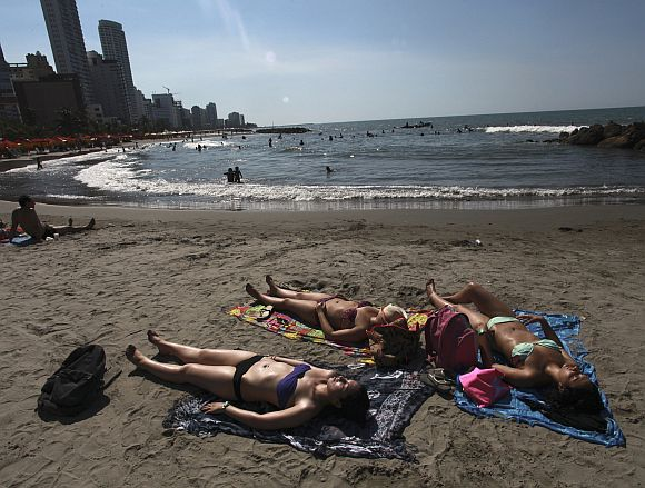 Tourists relax at Bocagrande beach in Cartagena, Colombia