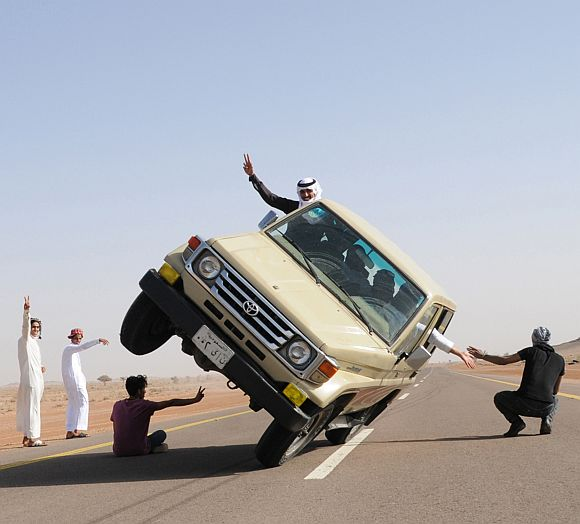 Saudi youths demonstrate a stunt known as