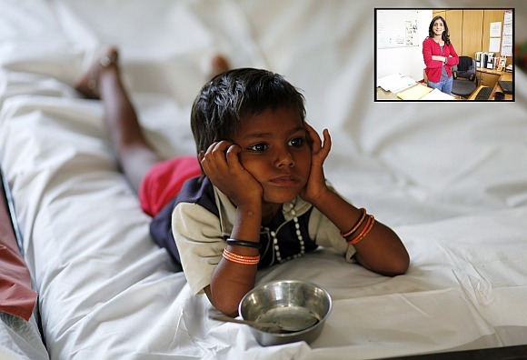 A malnourished child waits for food at the Nutritional Rehabilitation Centre in Sheopur district in Madhya Pradesh. (Inset) Dr Purnima Menon