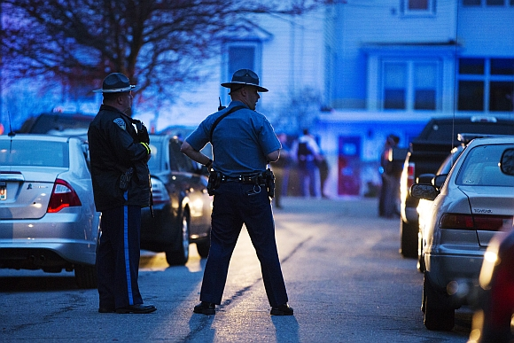 Law enforcement officials stand at the scene on Franklin St. as the search comes to an end in Watertown, Massachusetts