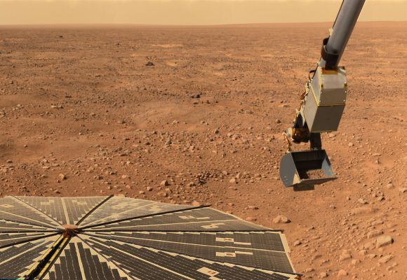 NASA's Phoenix Mars Lander's solar panel and the lander's robotic arm with a sample in the scoop are seen in this image taken on Mars.