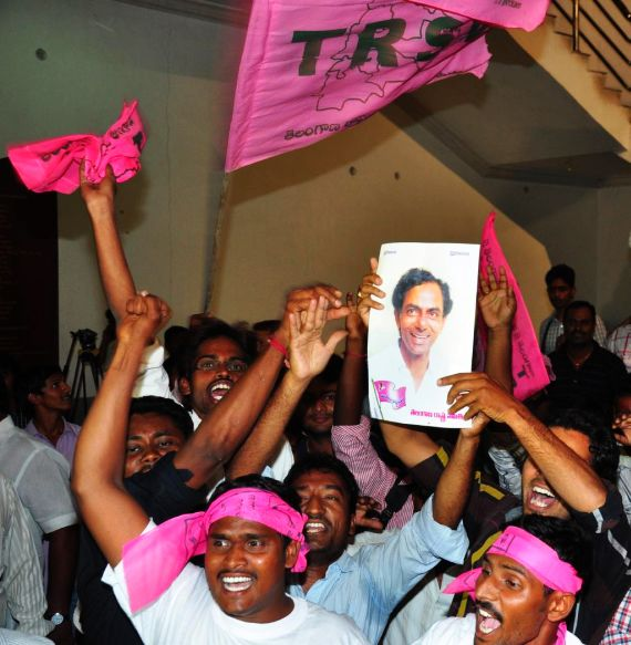TRS activists celebrate in Hyderabad after Congress announced commencement of Telangana formation process