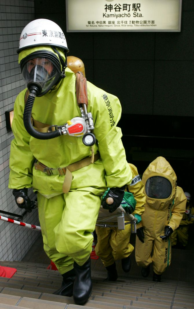 Special incident unit members from the Tokyo Fire Department and Tokyo Metropolitan Police Department conduct nuclear, biological and chemical disaster drills at Tokyo's Kamiyacho subway station