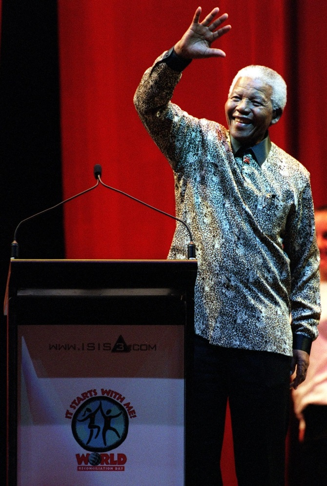 Nelson Mandela waves to the crowd at the World Reconciliation Day Concert, at the Colonial Stadium, on September 8, 2000, in Melbourne, Australia.