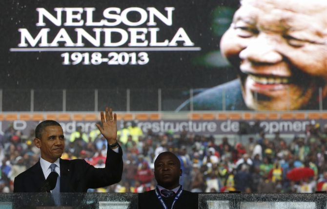 US President Barack Obama addresses the crowd during a memorial service for Nelson Mandela at FNB Stadium in Johannesburg, South Africa