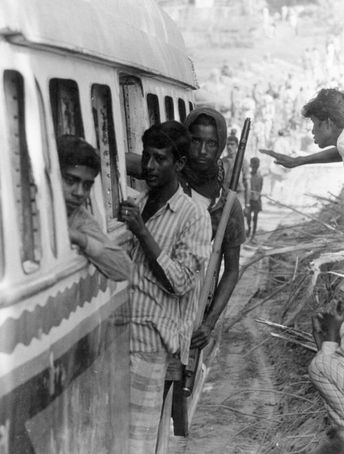 A 1971 photograph showing Mukti Bahini troops on their way to the frontlines in East Pakistan during the India-Pakistan conflict for the independence of  Bangladesh.