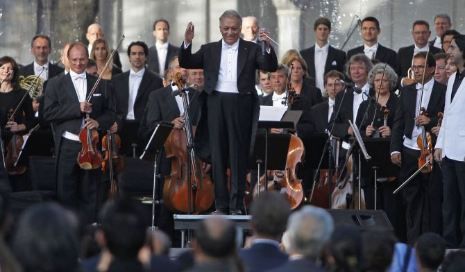 Renowned conductor Zubin Mehta gestures before performing at the Ehasas-e-Kashmir concert at Shalimar Garden on the outskirts of Srinagar.