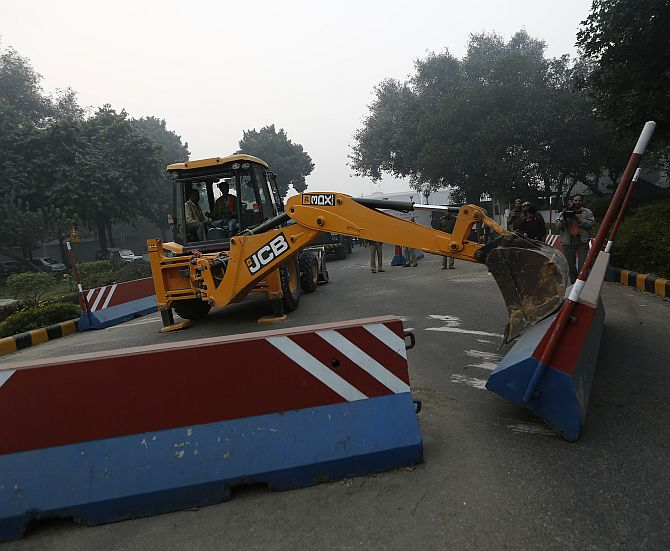 A bulldozer removes the security barriers in front of the US embassy in New Delhi