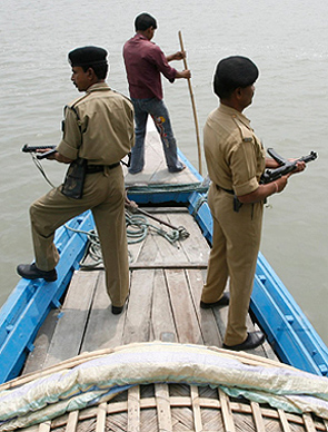 Border Security Force troopers patrol the Brahmaputra near the border with Bangladesh. Photograph: Rupak De Chowdhuri/Reuters