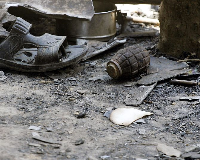 An unexploded grenade lies on the floor of a police camp after a Maoist attack in Rani Bodli village in Chhattisgarh