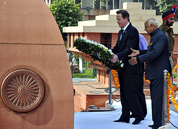 Then British prime minister David Cameron places a wreath at the Jallianwala Bagh memorial, February 23, 2013. Photograph: Munish Sharma/Reuters