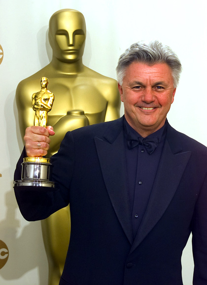 John Irving holds the Oscar he won for Best Screenplay Adaptation for the film 'The Cider House Rules',