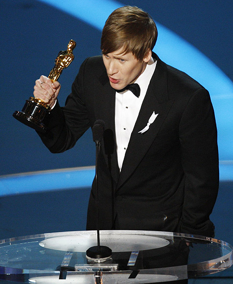 Dustin Lance Black holds the Oscar for best original screenplay for 'Milk' during the 81st Academy Awards in Hollywood, California on February 22, 2009