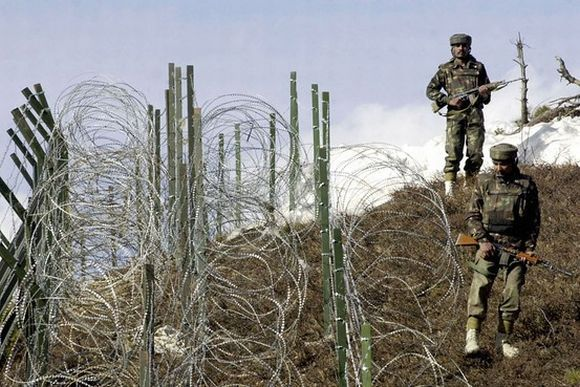 Indian soldiers patrol along the Indo-Pak border