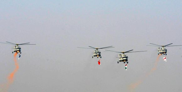 The IAF Helicopters carrying the tricolour and three services flag, during the 64th Republic Day parade at Rajpath