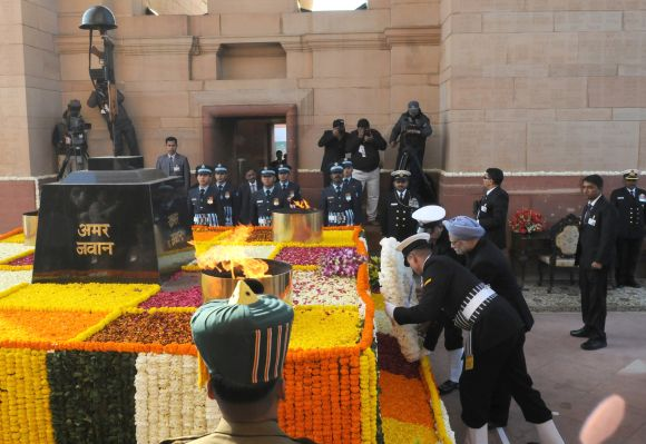 Prime Minister Manmohan Singh laying wreath at the Amar Jawan Jyoti on the occasion of the 64th Republic Day parade.