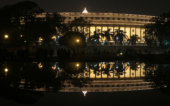 The Parliament building is illuminated during the ceremony in New Delhi