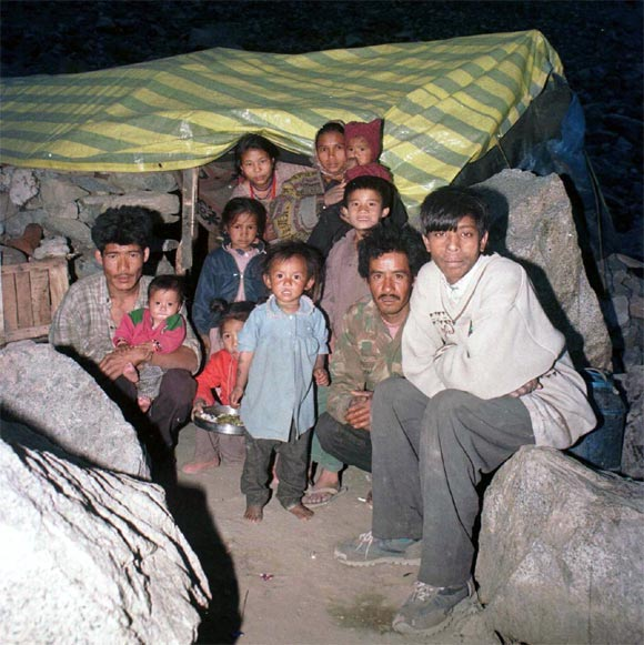 A family takes refuge in a makeshift tent on the outskirts of Kargil, May 26, 1999.