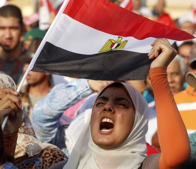 protester against Egyptian President Mohammed Morsi shouts slogans during a demonstration in Cairo