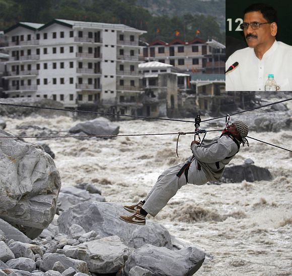 A man is pulled across to safety on a rope, as damaged buildings and the Alaknanda river are seen in the background, during a rescue operation in Govindghat in Uttarakhand (Inset) M Shashidhar Reddy