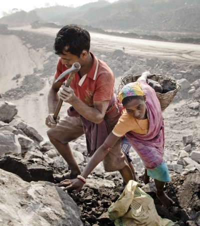 Local villagers scavenge coal illegally from an open-cast coal mine in the village of Jina Gora, Jharkhand. Photograph: Daniel Berehulak/Getty Images