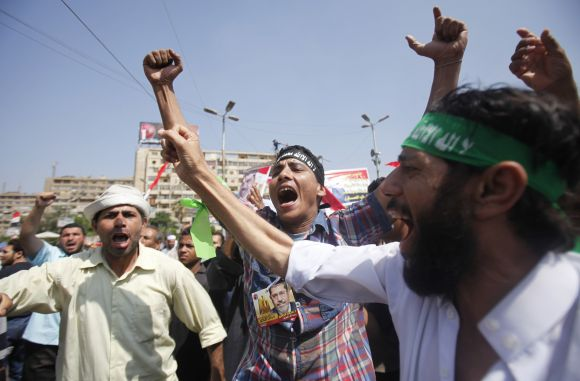 Members of Muslim Brotherhood shout slogans against army after clashes near Republican Guard headquarters