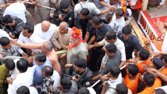 Security personnel make way for Modi at the yatra