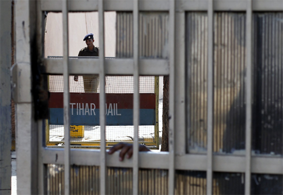 A policeman walks inside the Tihar Jail in New Delhi, where the main accused in the Delhi gang-rape hanged himself