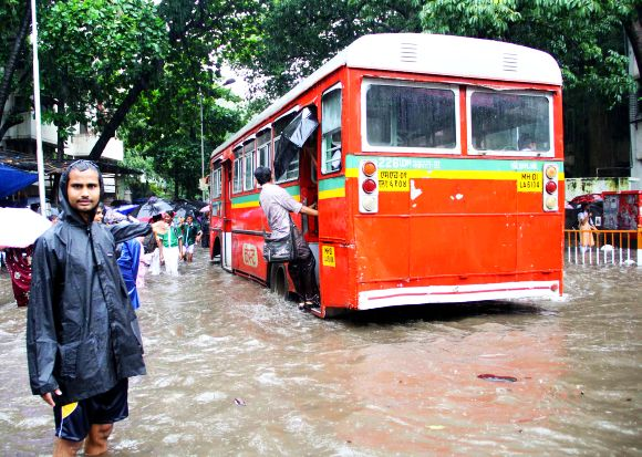 A BEST bus wades through waterlogged roads near the Sion railway station in Central Mumbai on Friday