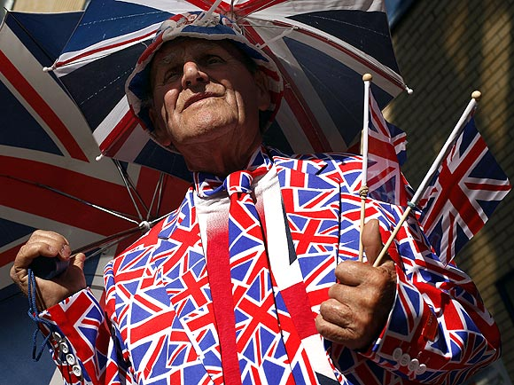 A royal supporter stands outside the Lindo Wing of St Mary's Hospital, where Britain's Catherine, Duchess of Cambridge is due to give birth