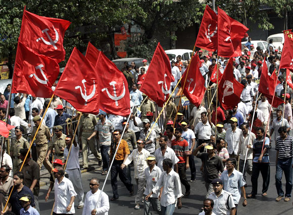 Activists of the CPI-M march during an election campaign rally
