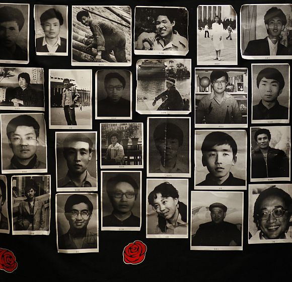 Photos of those who died in a military crackdown on pro-democracy movement at Beijing's Tiananmen Square in June 4, 1989, are displayed at a 'June 4 Memorial Museum' inside a university in Hong Kong