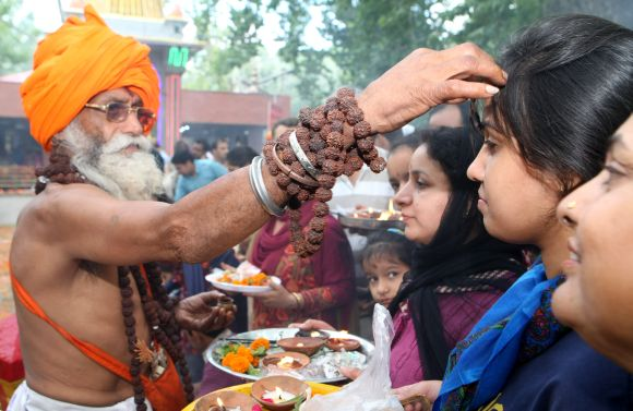A sadhu blesses devotees at Khir Bhawani temple in Kashmir