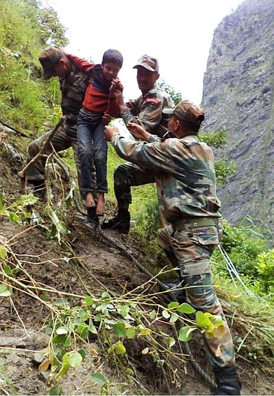 Indian Army personnel rescuing stranded people in rain-ravaged and landslide-hit Uttarakhand on Wednesday