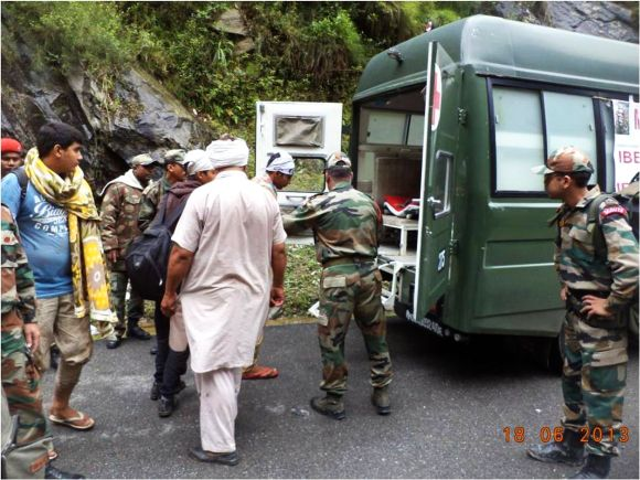 Army personnel shifting injured people to hospital in Uttarakhand