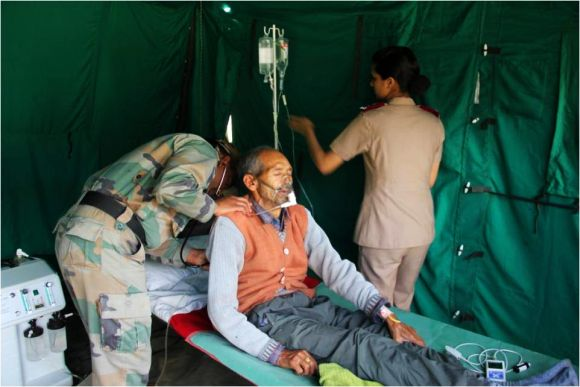 Army personnel providing medical aid to rescued people in flood-hit Uttarakhand on Thursday