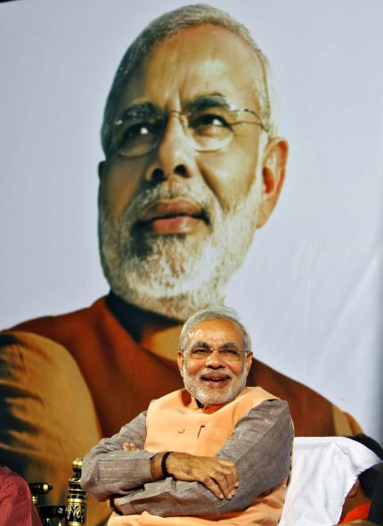 Gujarat's Chief Minister Narendra Modi smiles during an election campaign rally in Ahmedabad