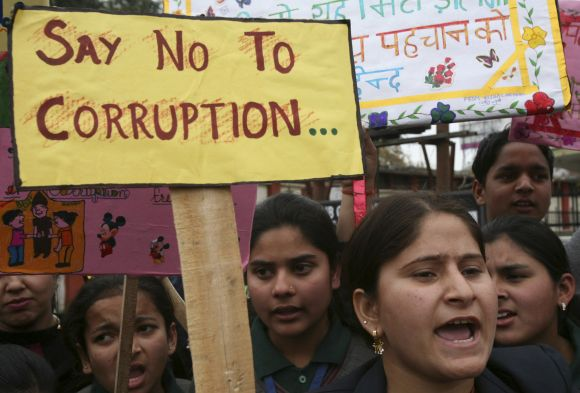 School students participate in an anti-corruption demonstration in Jammu