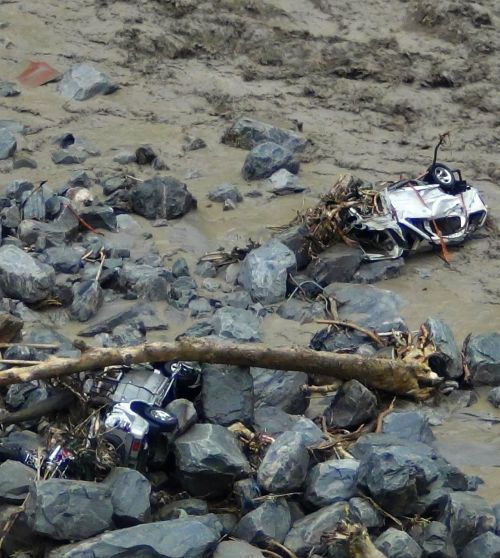 How Government Neglect Caused The Himalayan Tsunami  Rediffcom News Vehicles Are Pictured In The Flooded Waters Of A Stream After Heavy Rains  In Uttarakhand